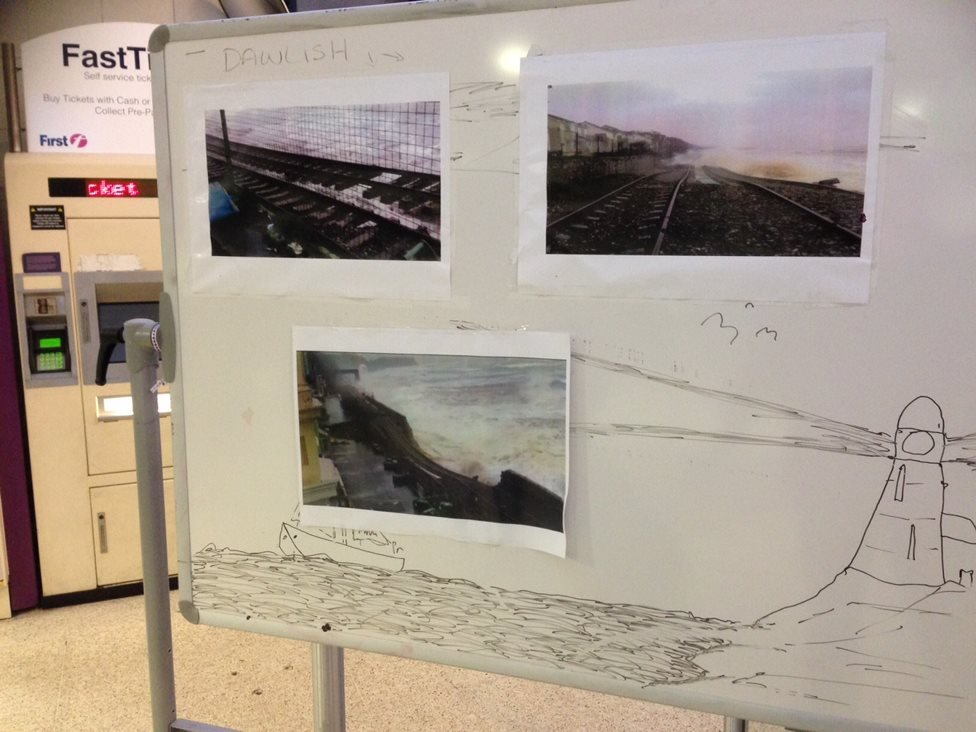 Pictures on an information board at Plymouth railway station