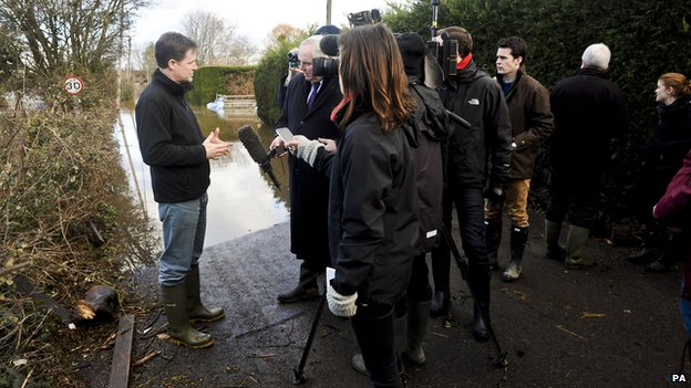 Deputy Prime Minister Nick Clegg is interviewed by the media next to the flooding sites at Burrowbridge, Somerset