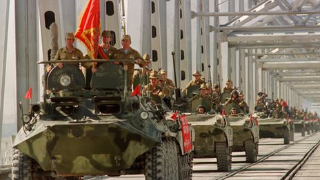 A column of Soviet armoured vehicles crossing Hairaton bridge as the pull out