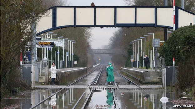 Flooded railway lines after the river Thames burst it's banks in Datchet, England