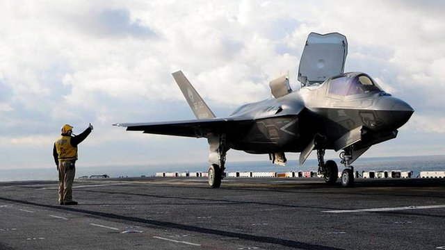 An F-35B prepares for take off from the flight deck of the amphibious assault ship USS Wasp