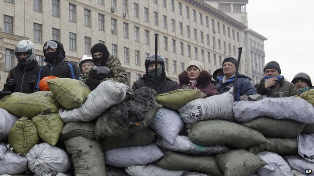 Protesters guard the barricade in front of riot police in Kiev, Ukraine, on 28 January 2014.