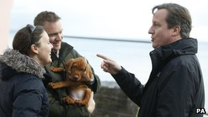 David Cameron talks to a couple who house was damaged in recent storms