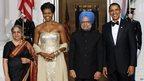 President Barack Obama, First Lady Michelle Obama, Indian Prime Minister Manmohan Singh and his wife Gursharan Kaur pose on 24 November 2009