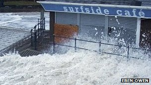 Waves lash into Surfside Cafe at Caswell Bay, Wales, January 4th 2014