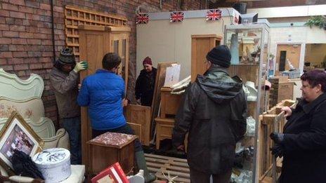 Volunteers move furniture