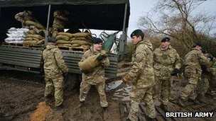 Soldiers fill sandbags