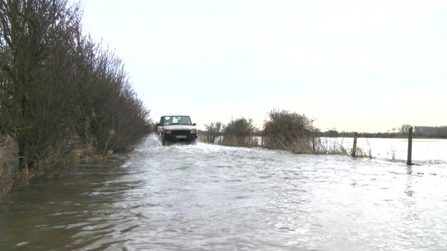 The Hook family drive through flooded fields