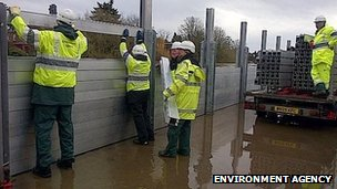 Workers raise river barrier at Bewdley