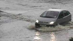 Car driving through flood water in Essex