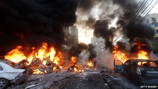 Flames rise after a car bomb blast in Beirut on January 2 2014