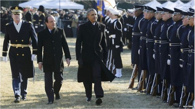 US President Barack Obama (middle) and French President Francois Hollande on the South Lawn at the White House on 11 February 2014