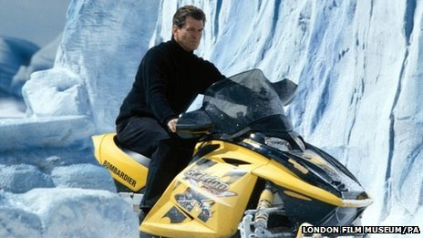 Pierce Brosnan on the Ski-doo snowmobile