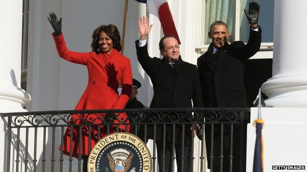 First Lady Michelle Obama (left), French President Francois Hollande (middle) and US President Barack Obama (right) at the White House on 11 February 2014