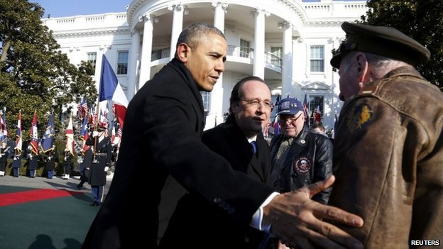 US President Barack Obama (left) and French President Francois Hollande on the South Lawn at the White House on 11 February 2014