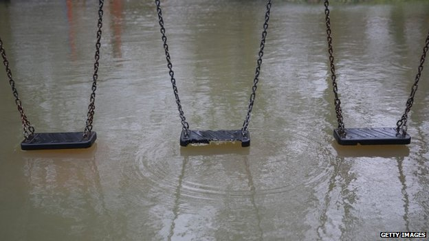 Flood water reaches a children's playground in Wraysbury