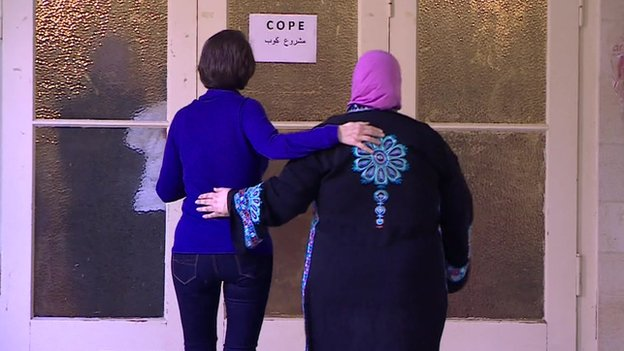 Ruth Ebenstein and Ibtisam Erekat enter a COPE breast-cancer support meeting in Jerusalem