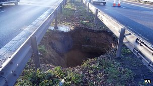 Handout photo dated 11/02/14 and issued by the Highways Agency of a 50ft-deep hole which appeared in the central reservation on a busy section of motorway on the M2 in north Kent