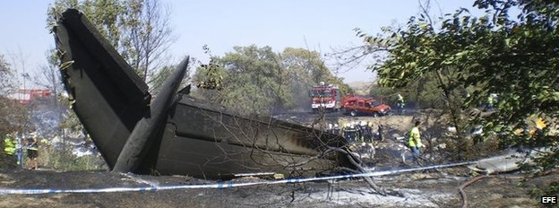 The tail of the Spanair jet that crashed on take off at Madrid airport is seen on 20 August 2008