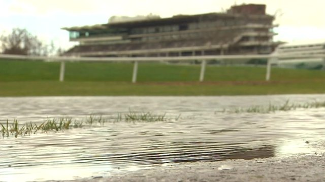 Rainwater gathers in puddles at Cheltenham Racecourse