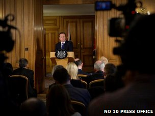 PM David Cameron takes questions on floods from gathered press at Downing Street this afternoon