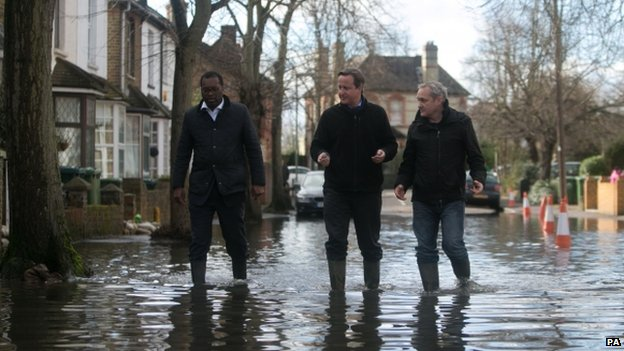 David Cameron with Spelthorne MP Kwasi Kwarteng (left) and a local resident