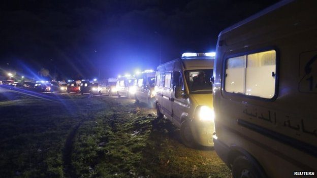 Ambulances transport the victims of a military plane crash in Oum al-Bouaghi province