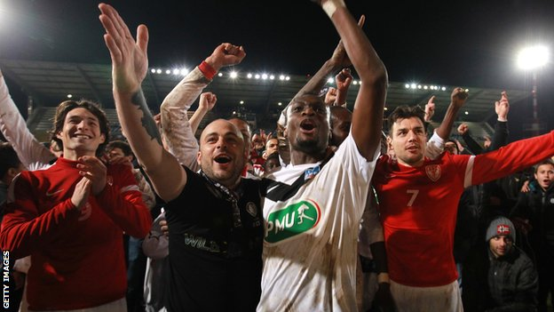 Cannes player and fans celebrate their French Cup win over Montpellier