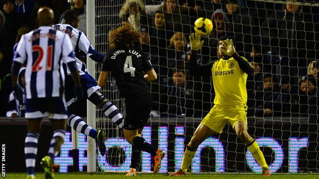 West Brom striker Victor Anichebe scores against Chelsea