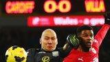 Villa goalkeeper Brad Guzan tangles with Cardiff striker Fraizer Campbell
