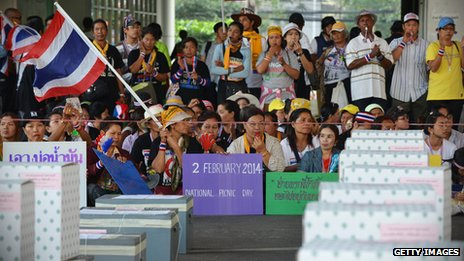 Anti-government protesters in front of ballot boxes at a polling station in Bangkok on 2 February 2014