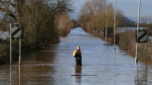 Man standing in flood water