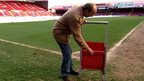 Jon Darch demonstrates new stadium safe standing seat
