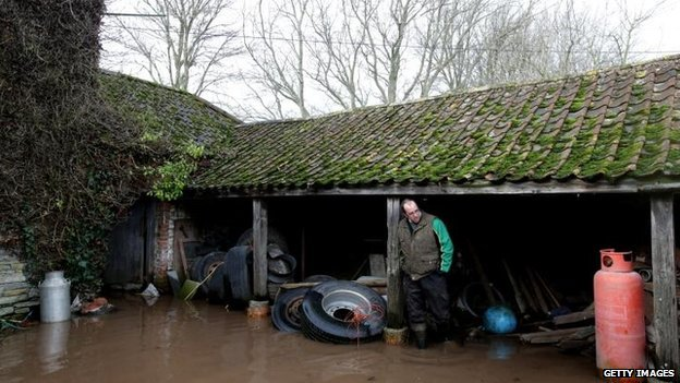 Farmer James Winslade looks at flood damage at his flooded farm in Moorland on January 28, 2014 in Somerset, England. The third-generation farmer, whose family has been farming the area for 150 years, calculates 94 percent of his farmland is under water