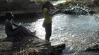 Alice Oleya Jino and friend splashing in the Fulla Falls in South Sudan
