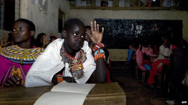Samburu children attending evening lessons in solar-lit classrooms at Loltulelei primary school in Kenya - 2012