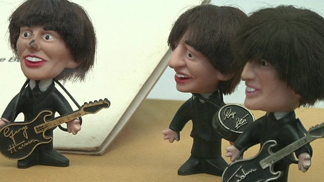 Miniature statues of English rock band The Beatles in a Mexico exhibition