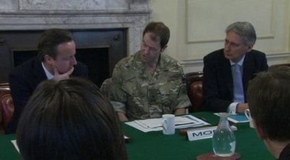 David Cameron, Maj Gen Patrick Sanders, and Defence Secretary Philip Hammond