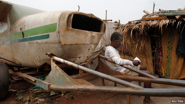 Displaced person at a camp at Bangui airport on 11 February 2014