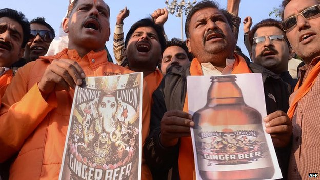 Activists of India's Shiv Sena party shout slogans as they protest against the Australian-based company Brookvale Union, manufacturer of an alcoholic ginger beer, during a demonstration in Amritsar on November 13, 2013.