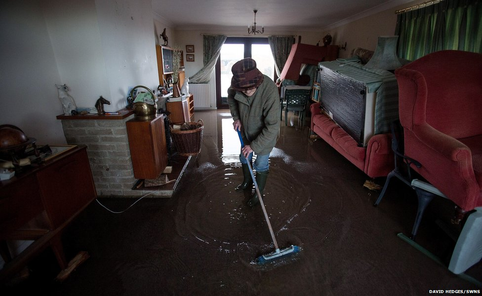 Pat Mennim, 77, in her flooded home in East Lyng, Somerset
