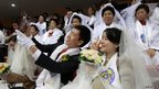 A couple take a selfie before a mass wedding ceremony at the CheongShim Peace World Center in Gapyeong, South Korea