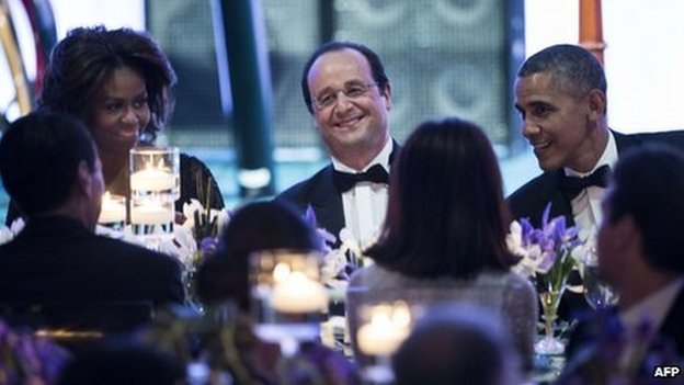 First Lady Michelle Obama (left), French President Francois Hollande (centre) and US President Barack Obama at a State Dinner at the White House on 11 February 2014