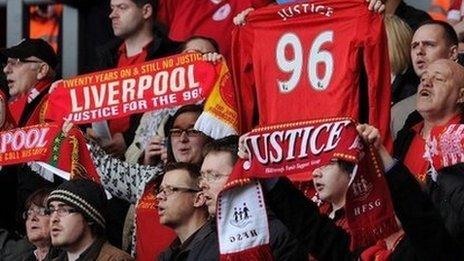 Liverpool fans holding Hillsborough scarves