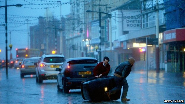 People struggle in the high winds at Blackpool promenade