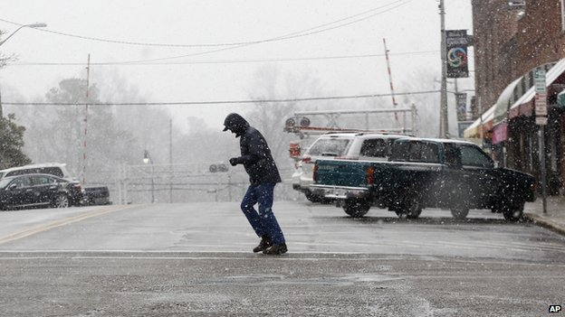 A pedestrian battled the snow and wind in Sanford, North Carolina on 11 February 2014