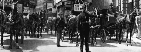 horses on a busy street