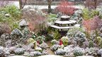 A Chinese style garden is covered in a dusting of snow.
