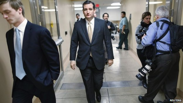 US Senator Ted Cruz walks to the Senate floor for a vote whether to raise the debt ceiling at the US Capitol in Washington 12 February 2014