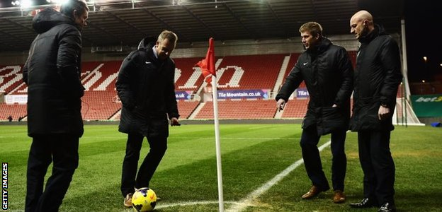 Officials test out pitch